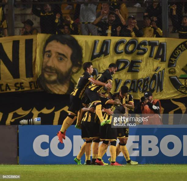 Uruguayan Penarol players celebrate after scoring against Argentinian Atletico Tucuman during their Copa Libertadores 2018 football match at the...