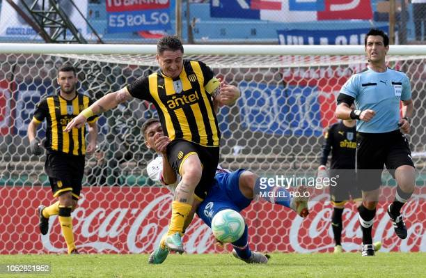 Uruguayan Penarol's Cristian Rodriguez vies for the ball with Uruguay's Nacional forward Brian Ocampo during the Uruguayan Clausura tournament derby...