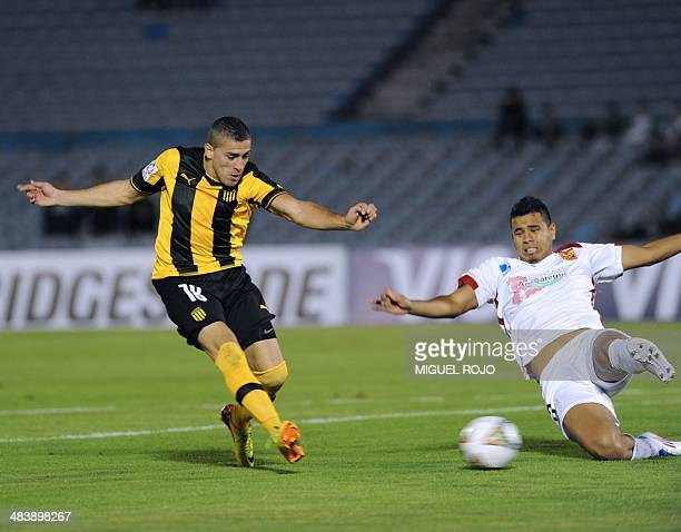 Uruguayan Penarol's Mauro Fernandez vies for the ball with Edgar Mendoza of Venezuelan Deportivo Anzoategui during their Libertadores Cup football...
