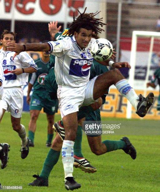 Uruguayan player Robert Lima of Olimpia fights for control of the ball 22 July 2001 in Tegucigalpa during the final match of the Clausura tournament...
