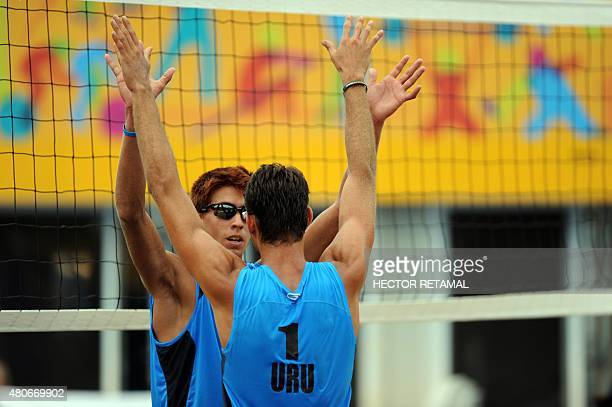 Uruguayan players celebrate after their in the Men's Beach Voleyball Preliminary against Guatemala at the 2015 Pan American Games in Toronto Canada...