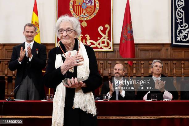 Uruguayan poet Ida Vitale bows after receiving the Cervantes Literature Prize from King Felipe VI of Spain during a ceremony at the University of...