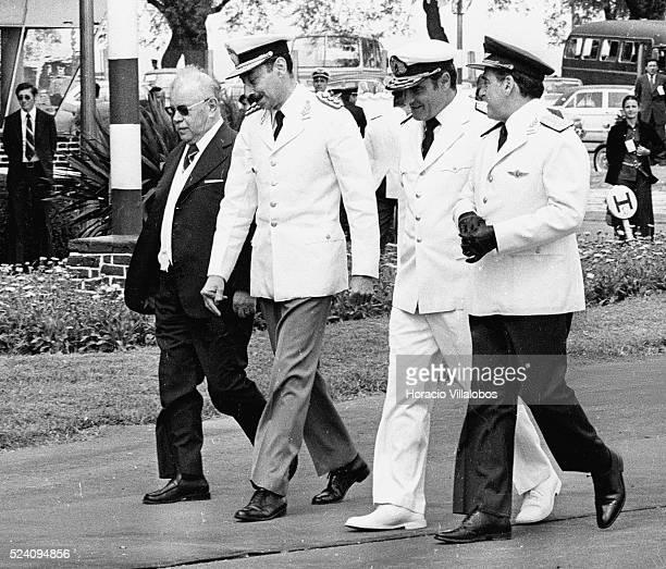 Uruguayan President Aparicio Mendez walks with Argentine military dictator Jorge Rafael Videla and the other members of the Argentine junta, Massera...
