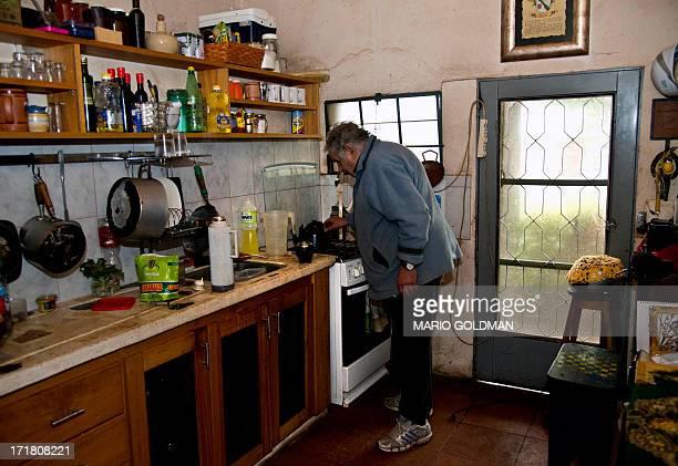 Uruguayan President Jose Mujica heats up water at his house in Montevideo on June 25 2013 AFP PHOTO / MARIO GOLDMAN