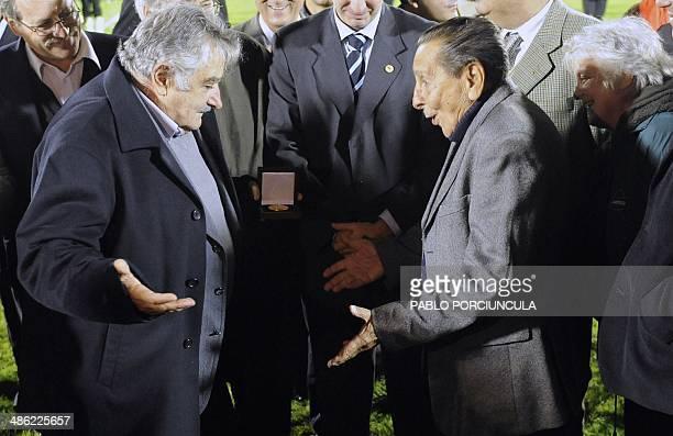 Uruguayan President Jose Mujica jokes with former 1950 WC champion Uruguayan Alcides Ghiggia as Uruguayan First Lady and Senator Lucia Topolansky...