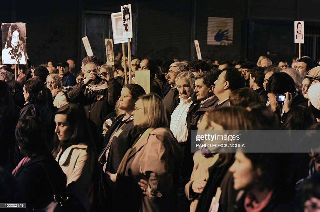 Uruguayan President Jose Mujica (C) marches with relatives of people disappeared during the country's last dictatorship (1973-84), during the annual 'March od Silence' in Montevideo, on May 20, 2010. AFP PHOTO/Pablo PORCIUNCULA