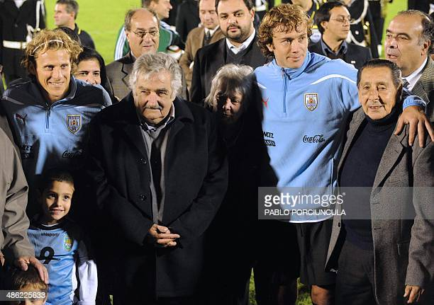 Uruguayan President Jose Mujica Uruguayan First Lady and Senator Lucia Topolansky and former 1950 World Cup champion Alcides Ghiggia stand next to...