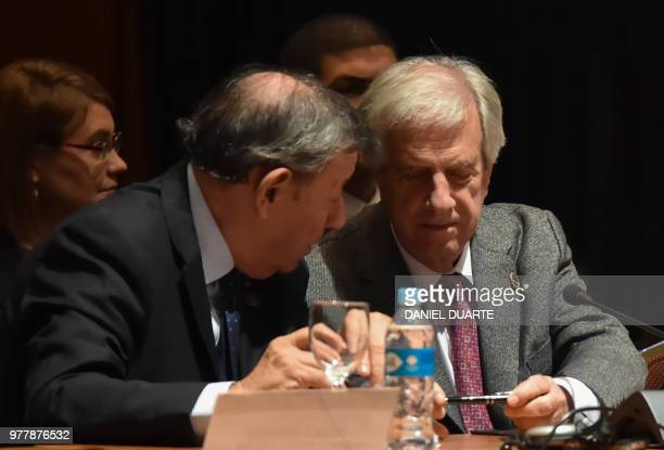 Uruguayan President Tabare Vazquez and his Foreign Minister Rodolfo Nin Novoa attend the Mercosur Summit in Luque Paraguay on June 18 2018 During the...