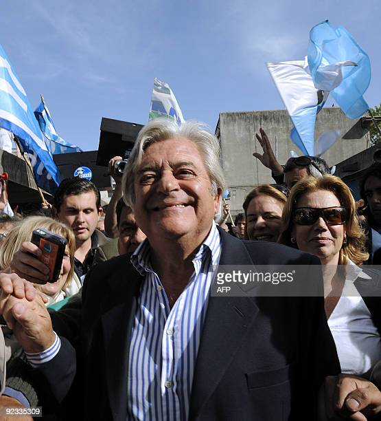 Uruguayan presidential candidate Luis Alberto Lacalle of the Partido Nacional walks accompanied by his wife Julia Pou de Lacalle before casting his...