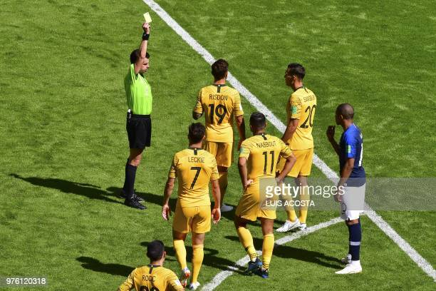 Uruguayan referee Andres Cunha presents Australia's defender Joshua Risdon with a yellow card during the Russia 2018 World Cup Group C football match...