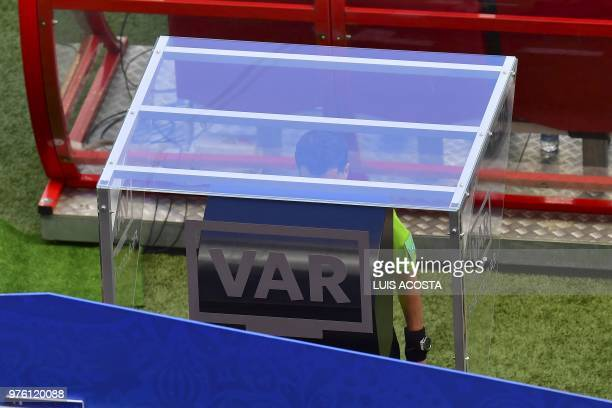 TOPSHOT Uruguayan referee Andres Cunha reviews the video replay during the Russia 2018 World Cup Group C football match between France and Australia...