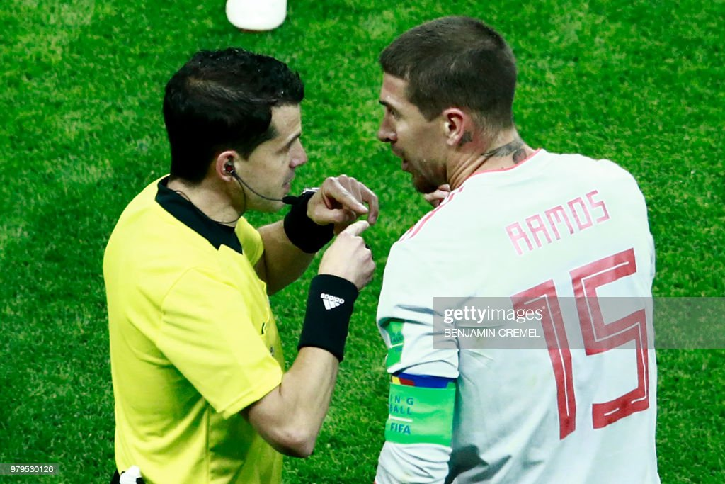 Uruguayan referee Andres Cunha (L) speaks with Spain's defender Sergio Ramos during the Russia 2018 World Cup Group B football match between Iran and Spain at the Kazan Arena in Kazan on June 20, 2018. (Photo by BENJAMIN CREMEL / AFP) / RESTRICTED