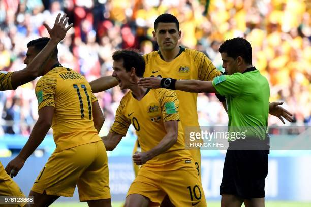 Uruguayan referee Carlos Cunha awards a penalty kick to Australia during the Russia 2018 World Cup Group C football match between France and...