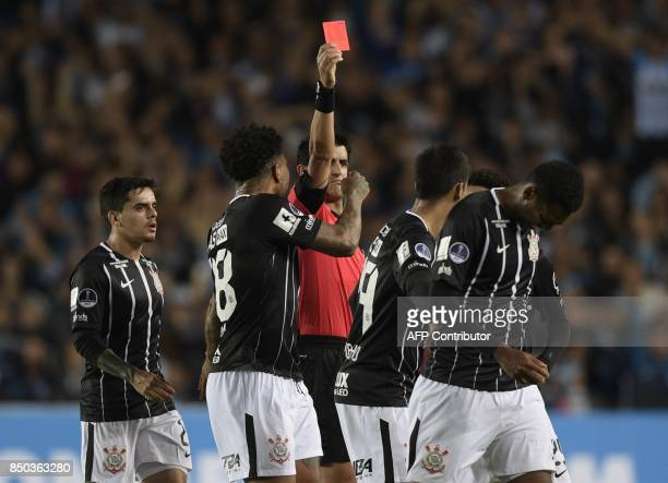 Uruguayan referee Leodan Gonzalez sends off Brazil's Corinthians forward Jo during the Copa Sudamericana round before the quarterfinals second leg...