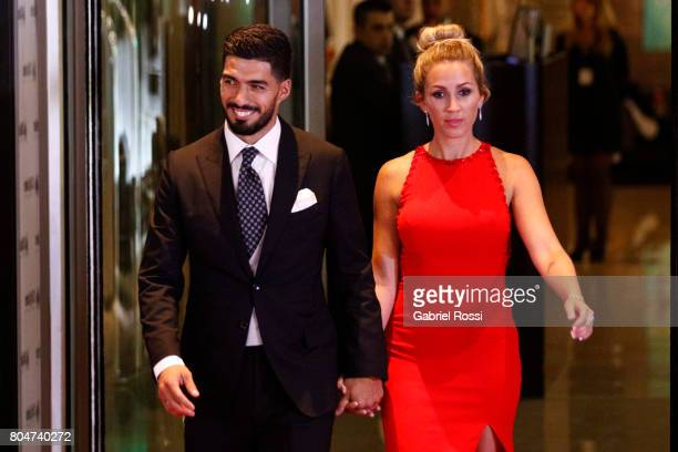 Uruguayan soccer player Luis Suarez and his wife Sofia Balbi pose for pictures on the red carpet during Lionel Messi and Antonela Rocuzzo's Wedding...