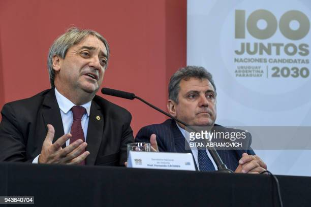 Uruguayan Sports Secretary Fernando Caceres speaks next to Uruguayan Football Association president Wilmar Valdez during a press conference on their...
