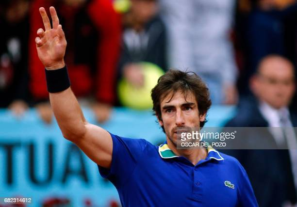 Uruguayan tennis player Pablo Cuevas celebrates after winning against German tennis player Alexander Zverev during the ATP Madrid Open quarter final...