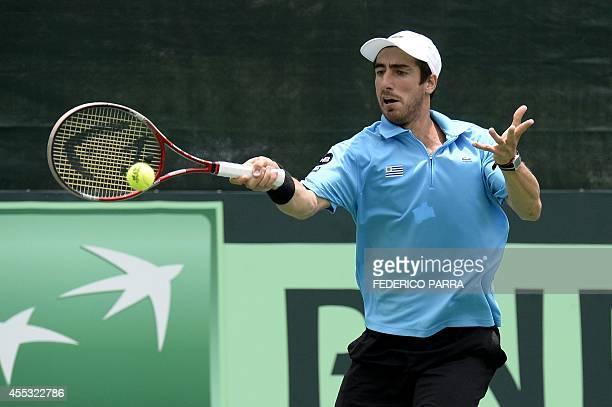 Uruguayan tennis player Pablo Cuevas hits a return to Venezuelan Jesus Bandres during their Davis Cup American Zone Group I singles match in Caracas...