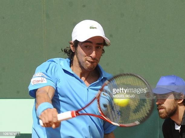 Uruguayan tennis player Pablo Cuevas returns the ball during his Davis Cup American Zone Group 1 match against Colombian Alejandro Falla, March 4,...