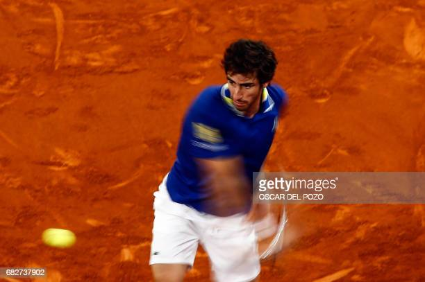 Uruguayan tennis player Pablo Cuevas returns the ball to Austrian tennis player Dominic Thiem during the ATP Madrid Open semifinal in Madrid, on May...