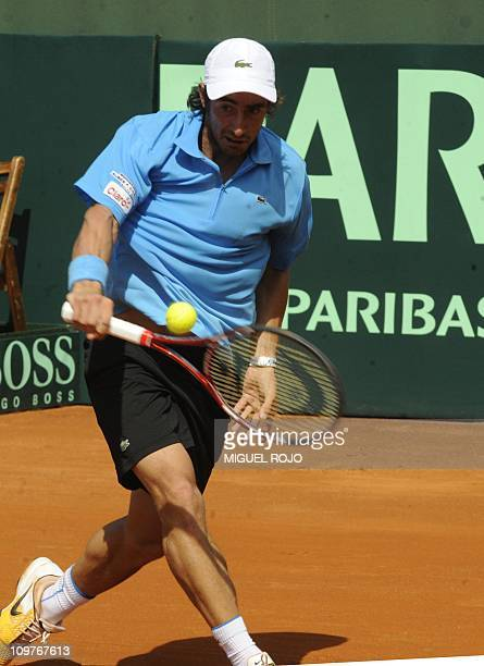 Uruguayan tennis player Pablo Cuevas returns the ball to Colombian Alejandro Falla during their Davis Cup match in Montevideo on March 4 2011 AFP...