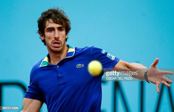 Uruguayan tennis player Pablo Cuevas returns the ball to German tennis player Alexander Zverev during the ATP Madrid Open quarter final match in...