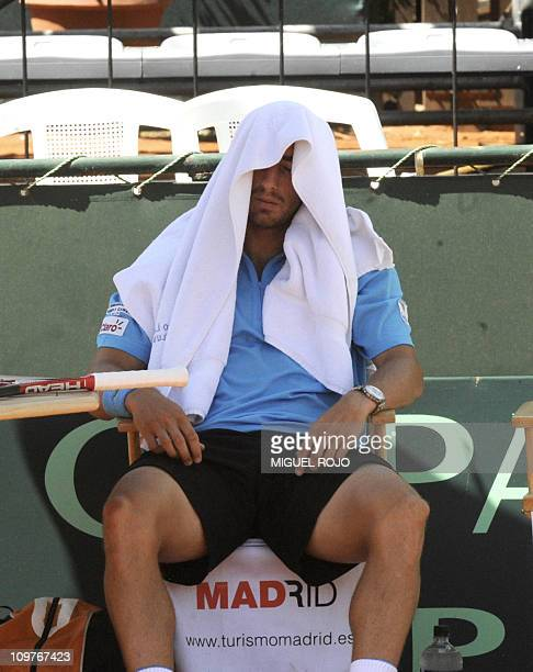 Uruguayan tennis player Pablo Cuevas takes a rest during his Davis Cup American Zone Group 1 match against Colombian Alejandro Falla, March 4, 2011...