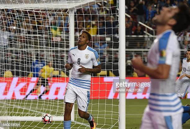 Uruguay's Abel Hernandez and Nicolas Lodeiro celebrate an own-goal by Jamaica's Je-Vaughn Watson during their Copa America Centenario football...
