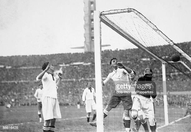Uruguay's Alvaro Gestido clashes with Peruvian goalkeeper Jorge Pardon during the FIFA World Cup match between Uruguay and Peru at the Estadio...