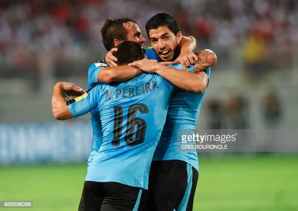 Uruguay's Alvaro Gonzalez Maximiliano Pereira and Luis Suarez celebrate after scoring against Peru during their 2018 FIFA World Cup qualifier...