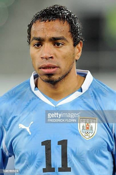 Uruguay's Alvaro Pereira listens to the national anthems ahead of the World Cup 2010 friendly football match Switzerland vs Uruguay at AFG Arena...