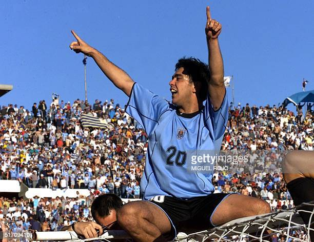 Uruguay's Alvaro Recoba celebrates after defeating Australia 30 during their match in Montevideo 25 November 2001 for the last spot of the 2002 FIFA...