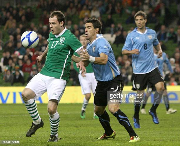 Uruguay's Andres Scotti and Republic of Ireland's Anthony Stokes battle for the ball