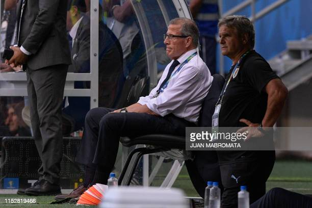 Uruguay's coach Oscar Washington Tabarez and assistant Celso Otero are pictured during the Copa America football tournament quarterfinal match...