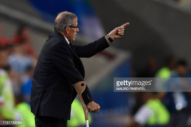 Uruguay's coach Oscar Washington Tabarez gives instructions during the Copa America football tournament group match against Chile at Maracana Stadium...
