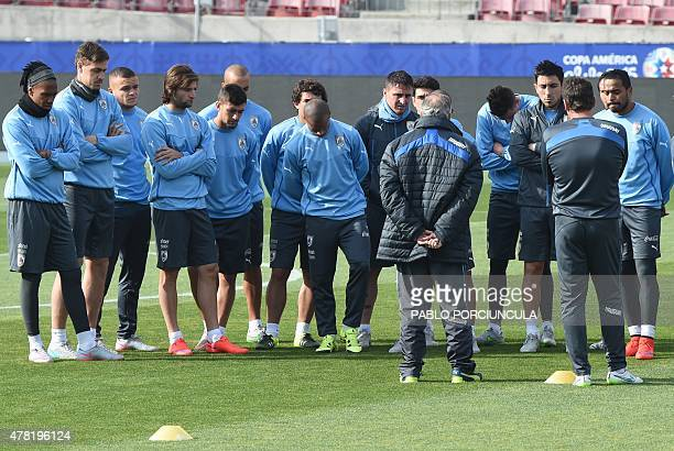 Uruguay's coach Oscar Washington Tabarez speaks to his footballers during a training session at the Nacional stadium in Santiago on June 23 2015...
