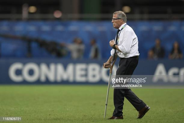 Uruguay's coach Oscar Washington Tabarez walks the pitch before the penalty shootout against Peru after tying 00 during their Copa America...