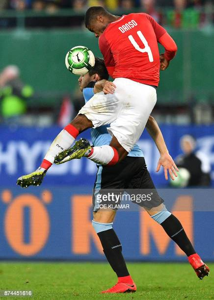 Uruguay's Cristian Stuani and Austria's Kevin Danso vie for the ball during an international friendly football match between Austria and Uruguay in...