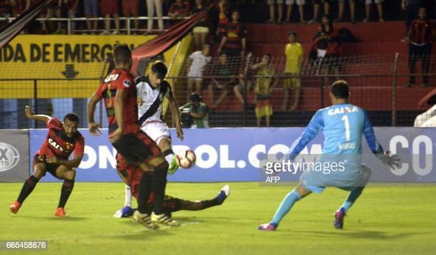 Uruguay's Danubio player Joaquin Ardaiz kicks the ball in a failed attempt to score in front of Brazil's Sport Recife goalkeeper Magrao during their...