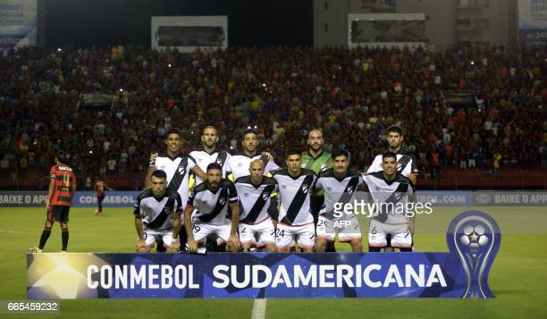 Uruguay's Danubio players pose for pictures before their Copa Sudamericana 2017 football match against Brazil's Sport Recife at the Adelmar da Costa...