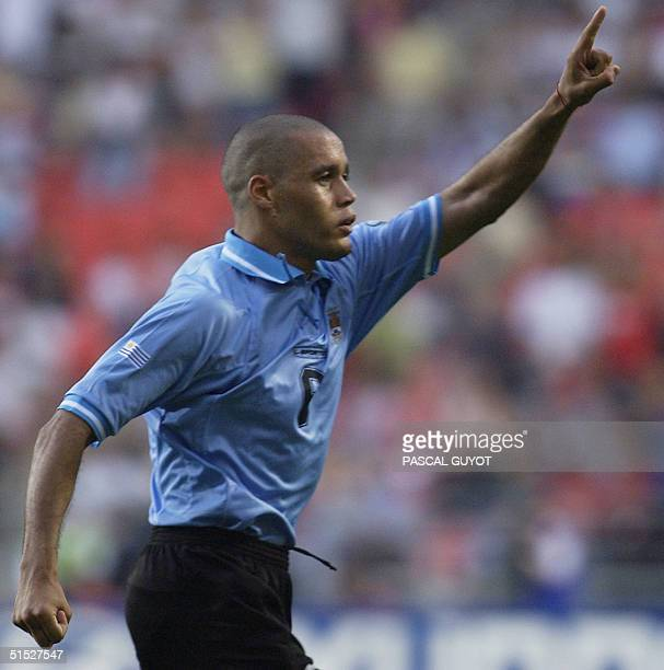 Uruguay's Dario Rodriguez celebrates after scoring a spectacular equalizer against Denmark two minutes into the second-half, 01 June 2002 at the...