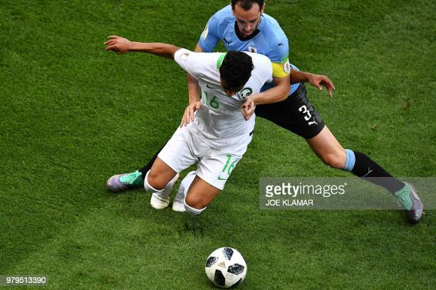Uruguay's defender Diego Godin fights for the ball with Saudi Arabia's midfielder Hussain Al Moqahwi during the Russia 2018 World Cup Group A...