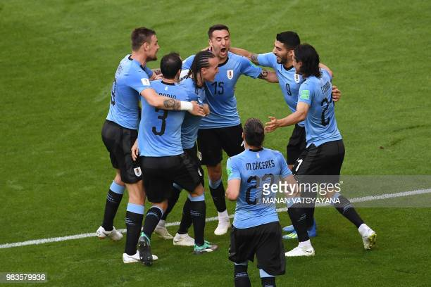 TOPSHOT Uruguay's defender Diego Laxalt celebrates with his teammates after scoring their second goal during the Russia 2018 World Cup Group A...