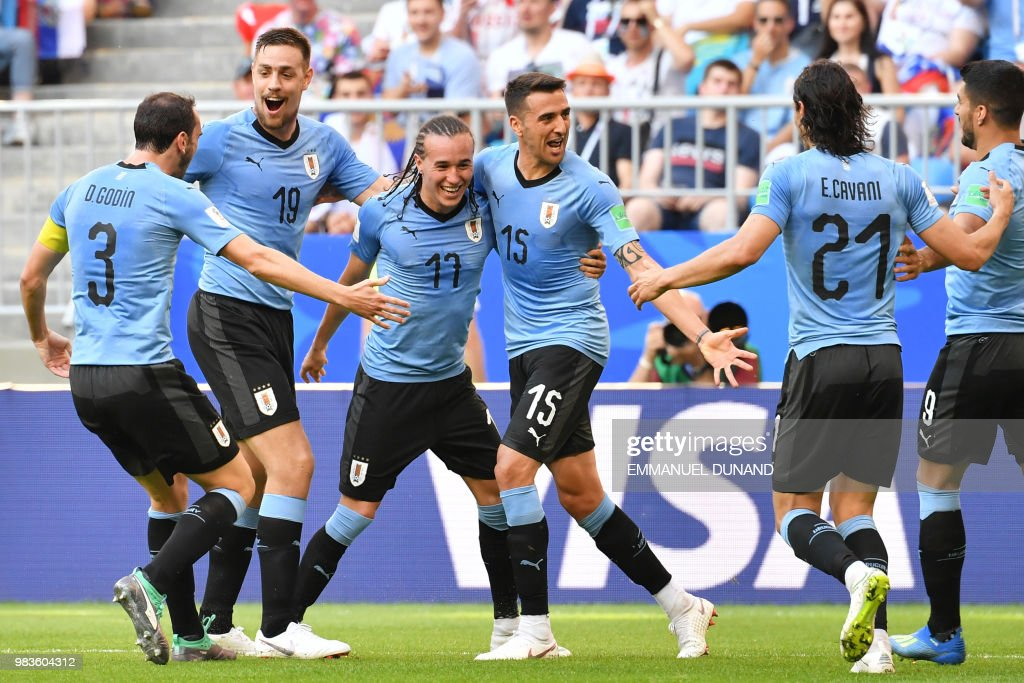 Uruguay's defender Diego Laxalt (3rd-L) celebrates with teammates after scoring a goal during the Russia 2018 World Cup Group A football match between Uruguay and Russia at the Samara Arena in Samara on June 25, 2018. (Photo by EMMANUEL DUNAND / AFP) / RESTRICTED