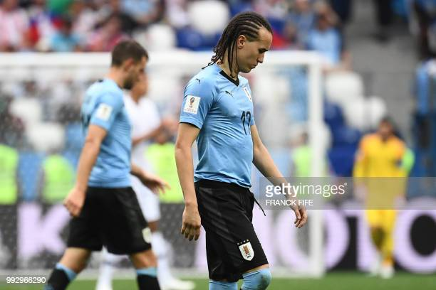 Uruguay's defender Diego Laxalt walks on the pitch during the Russia 2018 World Cup quarterfinal football match between Uruguay and France at the...