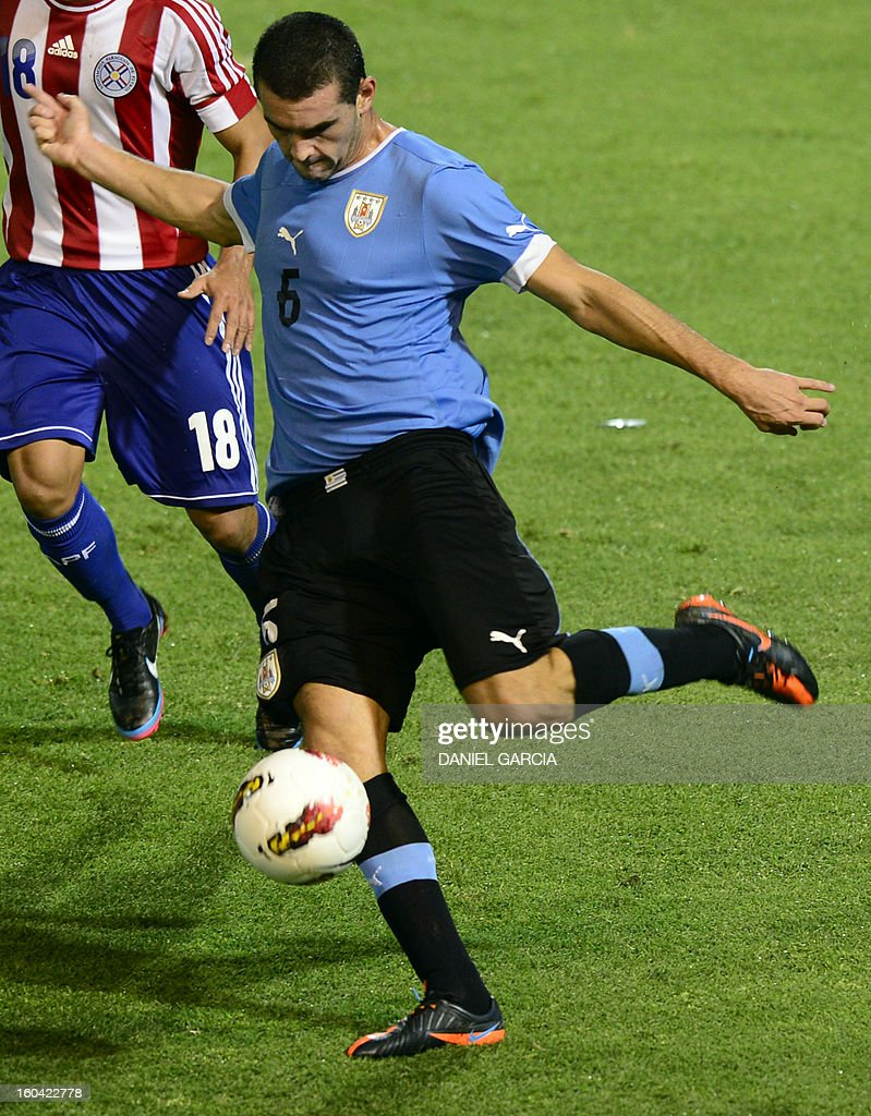 Uruguay's defender Fabricio Formiliano takes the ball with Uruguay's during their South American U-20 final round football match against Paraguay at Malvinas Argentinas stadium in Mendoza, Argentina, on January 30, 2013. Four teams will qualify for the FIFA U-20 World Cup Turkey 2013.