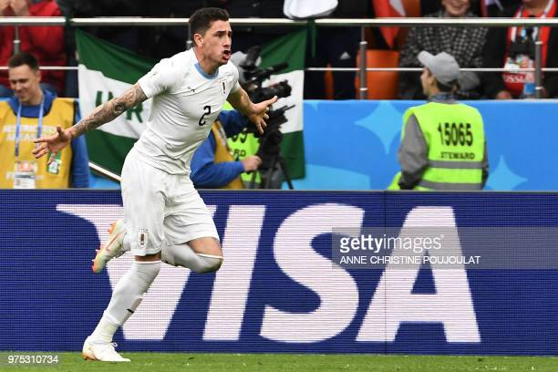 Uruguay's defender Jose Gimenez celebrates scoring the opening goal during the Russia 2018 World Cup Group A football match between Egypt and Uruguay...
