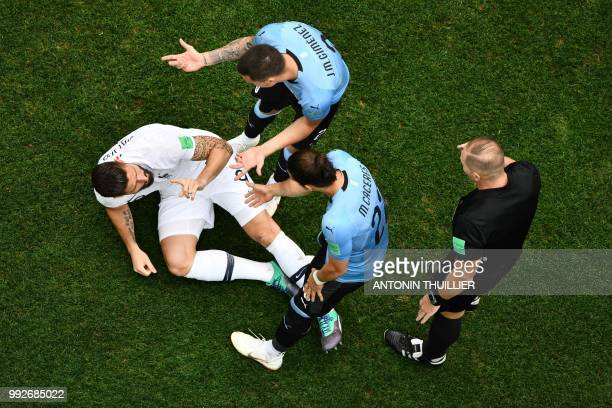 Uruguay's defender Jose Gimenez checks on France's forward Olivier Giroud during the Russia 2018 World Cup quarterfinal football match between...