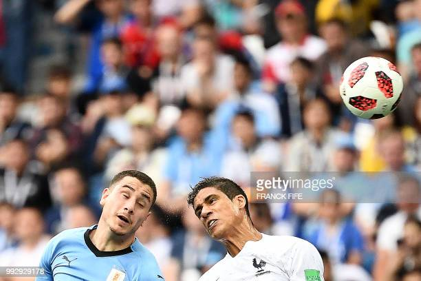 TOPSHOT Uruguay's defender Jose Gimenez vies with France's defender Raphael Varane during the Russia 2018 World Cup quarterfinal football match...