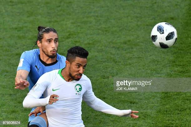 Uruguay's defender Martin Caceres fights for the ball with Saudi Arabia's midfielder Hatan Babhir during the Russia 2018 World Cup Group A football...